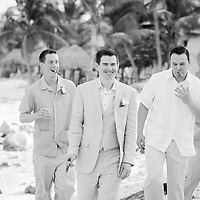 Dan and his groomsmen celebrate with cigars after his Akumal wedding to Casi.