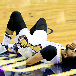Nov 12, 2016; New Orleans, LA, USA;  New Orleans Pelicans forward Anthony Davis (23) holds his back after hitting the floor during the third quarter of a game against the Los Angeles Lakers at the Smoothie King Center. Mandatory Credit: Derick E. Hingle-USA TODAY Sports