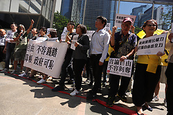 October 6, 2018 - Hong Kong, CHINA - In light of HKSARs refusal to renew working visa for British journalist Victor Mallet of FINANCIAL TIMES, Hong Kong citizens staged a protest outside Immigration Department stepping on a red cordon in a symbolic gesture expressing that the Hong Kong government have crossed the base line of universally  shared value of uphold and protect press freedom. Oct-6,2018 Hong Kong.ZUMA/Liau Chung-ren (Credit Image: © Liau Chung-ren/ZUMA Wire)