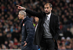 FC Barcelona's coach coach Pep Guardiola (r) and Arsenal's coach Arsene Wenger during UEFA Champions League match.March 8,2011.