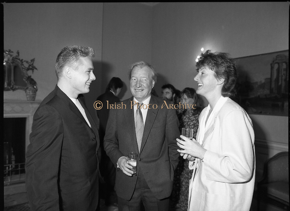 U2 Meet An Taoiseach, Charles Haughey.    (R58)..1987..18.05.1987..05.18.1987..18th May 1987..After their highly successful tour of America, An Taoiseach, Charles Haughey welcomed U2 back to Ireland with a reception held in Iveagh House, Dublin. Iveagh House formerly a home to the Guinness family is now held by the Department of Foreign Affairs...Image shows Larry Mullen taking time to share a joke with An Taoiseach,Charles Haughey, at the reception in Iveagh House.