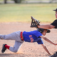 070114       Cable Hoover<br /> <br /> Ranger Isaiah Galaviz (4) dives back to first base as White Sox Isaac Gonzales (13) reaches for the pick off throw Tuesday at Indian Hills Park.