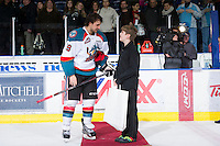 KELOWNA, CANADA - JANUARY 11:  Dylen McKinlay #19 of the Kelowna Rockets accepts a star of the game award against the Tri City Americans at the Kelowna Rockets on January 11, 2013 at Prospera Place in Kelowna, British Columbia, Canada (Photo by Marissa Baecker/Shoot the Breeze) *** Local Caption ***