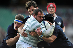 Williams Briggs of Cambridge University is tackled in possession - Photo mandatory by-line: Patrick Khachfe/JMP - Mobile: 07966 386802 11/12/2014 - SPORT - RUGBY UNION - London - Twickenham Stadium - Oxford University v Cambridge University - The Varsity Match