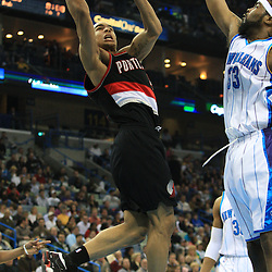 02 February 2009: Portland Trailblazers guard Jerryd Bayless (4) shoots over New Orleans Hornets center Melvin Ely (33) during a 97-89 loss by the New Orleans Hornets to the Portland Trail Blazers at the New Orleans Arena in New Orleans, LA.