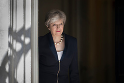 © Licensed to London News Pictures. 05/07/2017. London, UK. British Prime Minister Theresa May walks out to meet with Ukrainian Prime Minister Volodymyr Groysman in Downing Street. Photo credit: Peter Macdiarmid/LNP