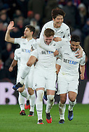 Alfie Mawson of Swansea City celebrates after scoring the opening goal with Neil Taylor (right) and Ki Sung-Yueng (middle) during the Premier League match at Selhurst Park, London<br /> Picture by Alan Stanford/Focus Images Ltd +44 7915 056117<br /> 03/01/2017
