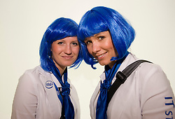 HANNOVER, GERMANY - MARCH-6-2008 - Marlene Goehring (left) and Janine Tilli, were part of the blue haired army of mavens Intel employed as hostesses during CeBIT 2008 in Hannover, Germany. (Photo © Jock Fistick)