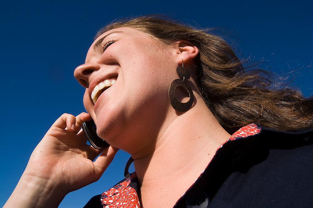 Emma Jubinski laughs while speaking on her cellphone in Seattle, Washington.