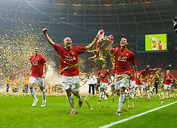 MOSCOW, RUSSIA - Wednesday, May 21, 2008: Manchester United's Rio Ferdinand and Wes Brown celebrate with the European Cup after beating Chelsea on sudden death penalties to win the UEFA Champions League Final at the Luzhniki Stadium. (Photo by David Rawcliffe/Propaganda)