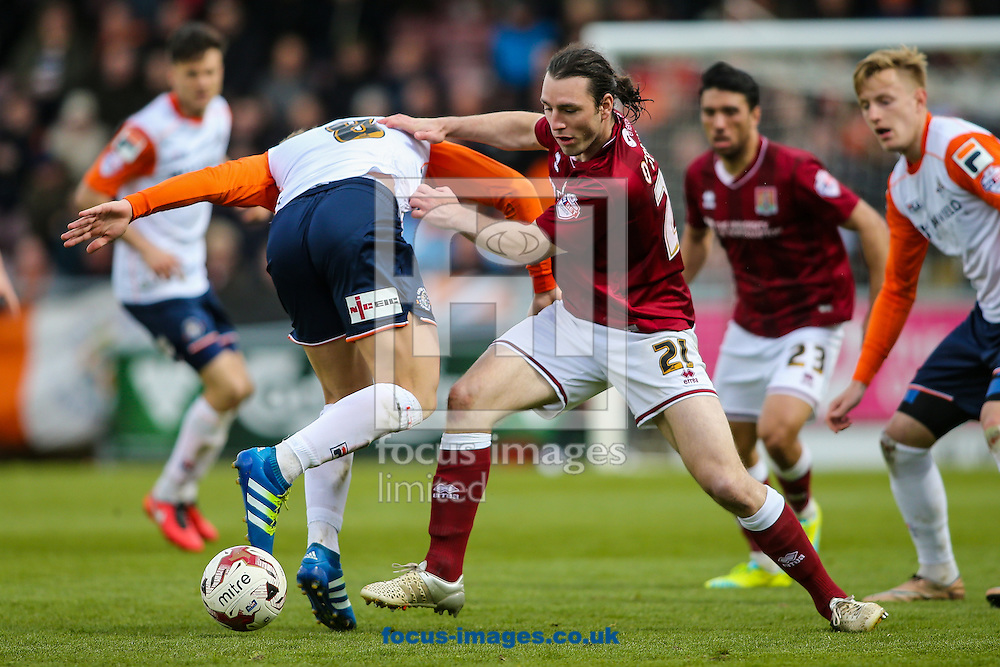 John-Joe O'Toole of Northampton Town (right) competing with Cameron McGeehan of Luton Town (left) during the Sky Bet League 2 match at Sixfields Stadium, Northampton<br /> Picture by Andy Kearns/Focus Images Ltd 0781 864 4264<br /> 30/04/2016