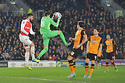 Hull City goalkeeper Eldin Jakupovic (16) takes the ball before Olivier Giroud of Arsenal FC (12) can get to it  during the The FA Cup fifth round match between Hull City and Arsenal at the KC Stadium, Kingston upon Hull, England on 8 March 2016. Photo by Ian Lyall.