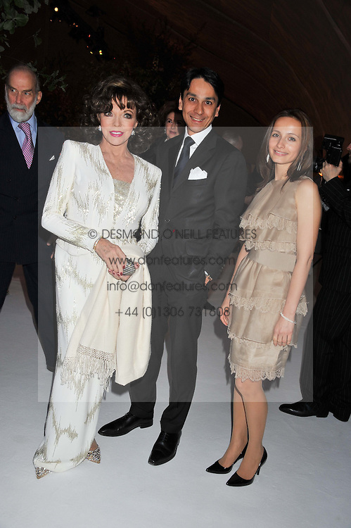 Left to right, JOAN COLLINS and FRANCOIS & LIUDMILA LE TROQUER at a dinner hosted by Cartier following the following the opening of the Chelsea Flower Show 2012 held at Battersea Power Station, London on 21st May 2012.