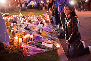 tucsonshooting - 09 JANUARY 2011 - TUCSON, AZ: Juni Escamillas (CQ) 11, prays at a memorial for Gabrielle Giffords at University Medical Center in Tucson Sunday night. Congresswoman Gabrielle Giffords, US Federal Judge John Roll and several other people were shot by a lone gunman in a mass shooting Saturday.     ARIZONA REPUBLIC PHOTO BY JACK KURTZ