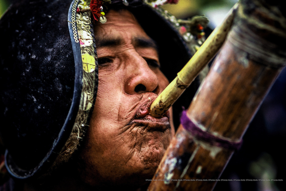 The Pujllay, the traditional carnival of Tarabuco. In commemoration the victory of their ancestors on top of the Spanish troops in 1816, peasants of all the closer communities meet in Tarabuco dressing their better attires, full with coloring to dance their ancestral music. Bolivia.