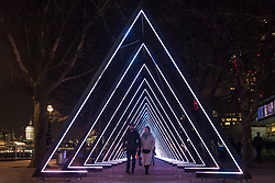"© Licensed to London News Pictures. 17/01/2018. LONDON, UK.  ""The Wave"" by Vertigo installed on the South Bank.  Preview of  Lumiere London, the capital's largest arts festival commissioned by The Mayor of London and produced by Artichoke.  Light installations by leading artists have been set up, both north and south of the river.  Photo credit: Stephen Chung/LNP"