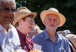 © Licensed to London News Pictures.  22/07/2018; Tolpuddle, Dorset, UK. JEREMY CORBYN, leader of the Labour Party, attends the wreath laying at the grave of Tolpuddle Martyr James Hammett at the church in the village of Tolpuddle, part of the Tolpuddle Martyrs Festival. The Tolpuddle Martyrs Festival for trade unionism, held every year, commemorates the birth of the trade union movement in the 19th century when the Tolpuddle Martyrs were transported to Australia for forming a trade union of agricultural labourers in Dorset. This year is also the 150th anniversary of the TUC. Photo credit: Simon Chapman/LNP