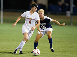 Virginia Cavaliers forward Lauren Alwine (9) dribbles around Georgetown Hoyas defender Laura Snyder (16).  The #6 Virginia Cavaliers played the Georgetown Hoyas to a 2-2 draw in a NCAA Women's Soccer pre-season exhibition game held at Klockner Stadium on the Grounds of the University of Virginia in Charlottesville, VA on August 18, 2008.
