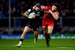 Jack Nowell of Exeter Chiefs is tackled by Owen Farrell of Saracens - Mandatory by-line: Ryan Hiscott/JMP - 29/12/2019 - RUGBY - Sandy Park - Exeter, England - Exeter Chiefs v Saracens - Gallagher Premiership Rugby