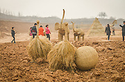 LUOYANG, CHINA - MARCH 16: (CHINA OUT) <br /> <br /> Citizens look straw ostriches and straw elephants at a construction site on March 16, 2016 in Luoyang, Henan Province of China. Various straw dolls like dinosaurs, ducks, Minions, elephants, pandas and small trains as well we others are made at a construction site which attracted citizens and visitors.<br /> ©Exclusivepix Media