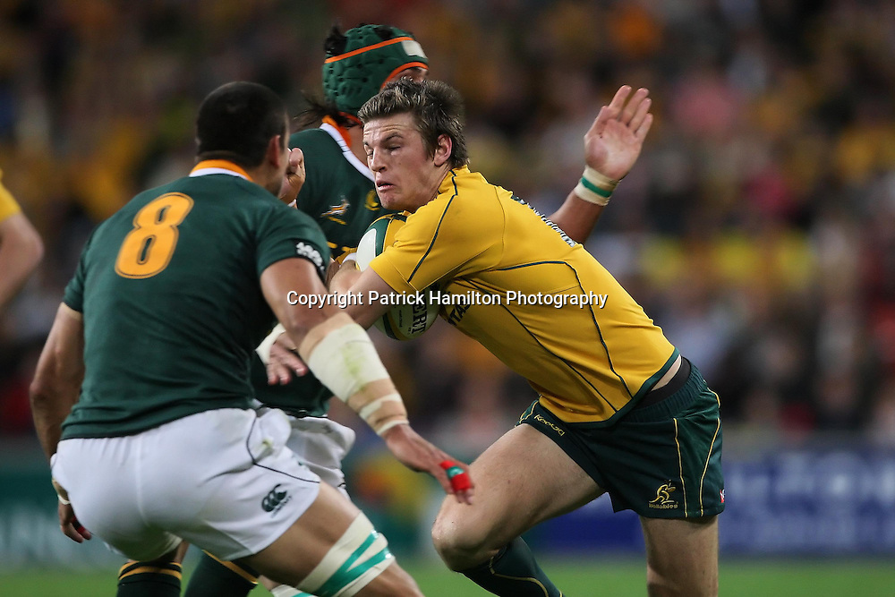 Rob Horne runs at Pierre Spies during the Tri-Nations rugby Test at Suncorp Stadium in Brisbane,  July 24, 2010.The Wallabies again ran the world champion Springboks into submission to win the second Tri-nations rugby Test 30-13 .
