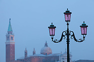 An ornate streetlamp with San Giorgio Maggiore in background, Venice, Italy.