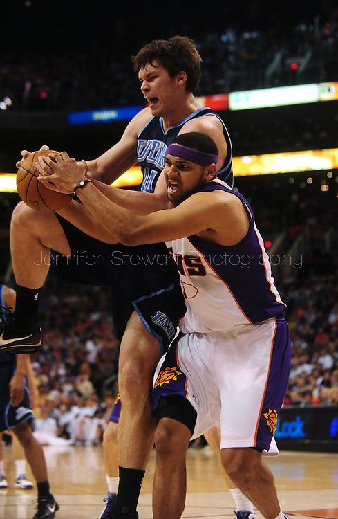 Mar. 19 2010; Phoenix, AZ, USA; Utah Jazz center Kyrylo Fesenko (44) and Phoenix Suns forward Jared Dudley (3) fight for a rebound in the first half at the US Airways Center. Mandatory Credit: Jennifer Stewart-US PRESSWIRE.