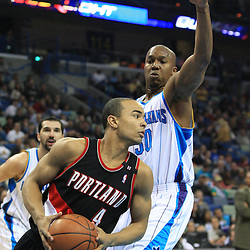 02 February 2009: Portland Trailblazers guard Jerryd Bayless (4) drives past New Orleans Hornets forward David West (30) during a 97-89 loss by the New Orleans Hornets to the Portland Trail Blazers at the New Orleans Arena in New Orleans, LA.