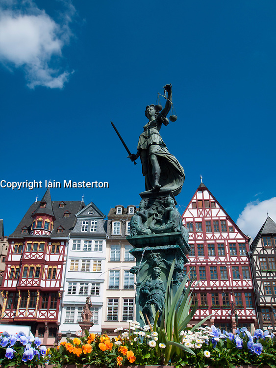Romer Square with historic timbered houses  and Justitia fountain statue in old town Frankfurt am Main  Germany