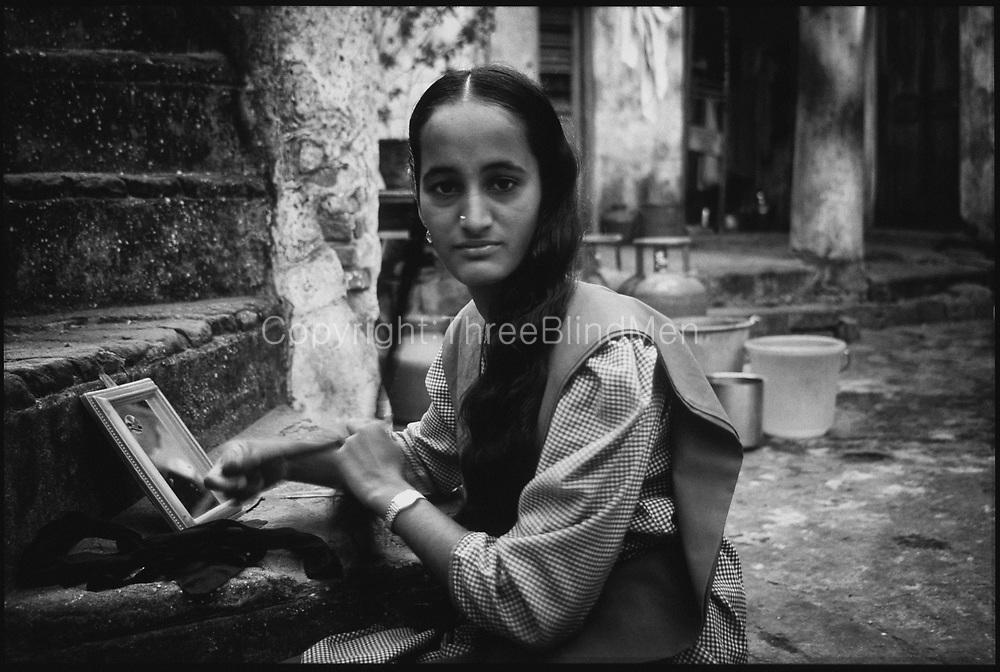 School girl preparing for school. Chennai. Morning.