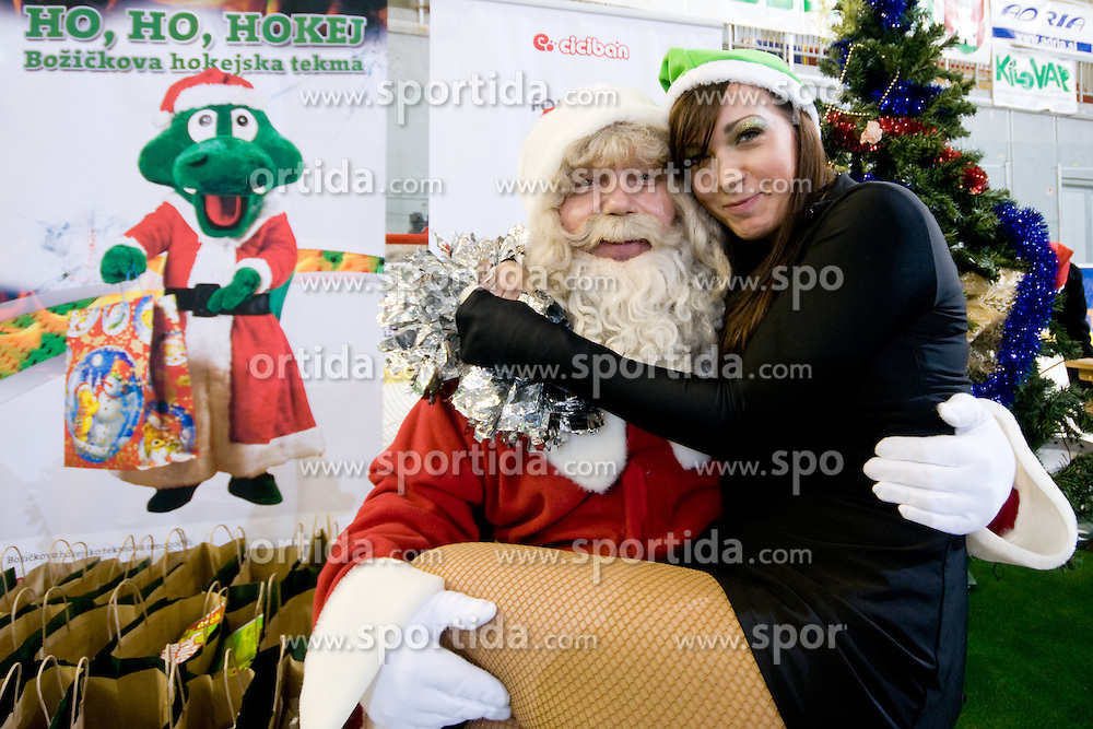 Santa Clause with Ice Ladies girl Maja Mladenovic after ice-hockey match between HDD Tilia Olimpija and EC Red Bull Salzburg in 29th Round of EBEL league, on December 23, 2010 at Hala Tivoli, Ljubljana, Slovenia. (Photo By Matic Klansek Velej / Sportida.com)
