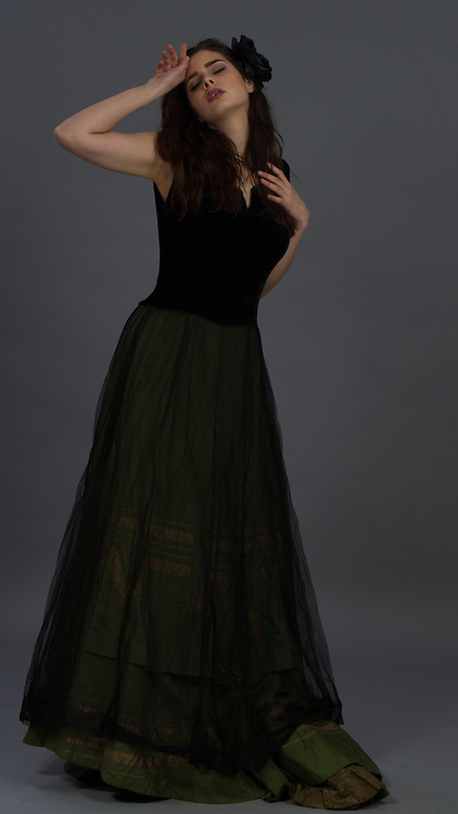 Female model posing in a Victorian outfit.