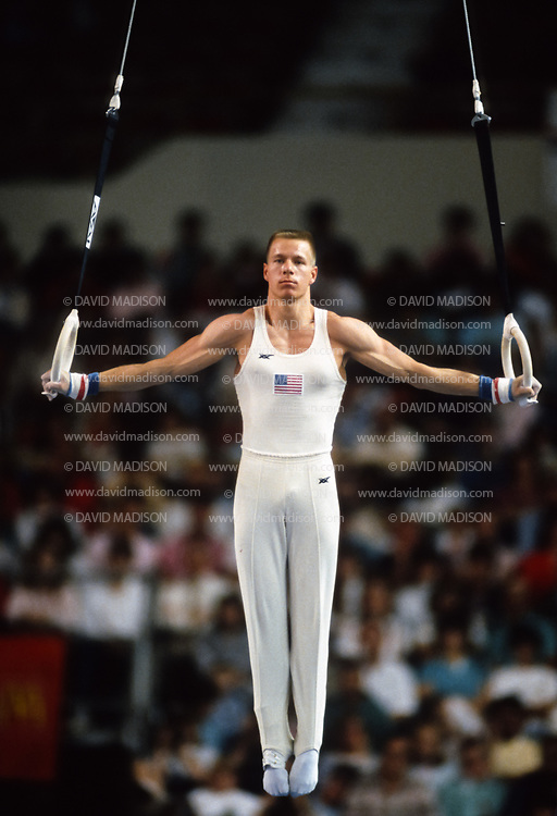 PHOENIX - APRIL 24:  Dan Hayden of the United States competes on the still rings during a USA - USSR gymnastics meet on April 24, 1988  at the Arizona Veterans Memorial Coliseum in Phoenix, Arizona.  (Photo by David Madison/Getty Images)