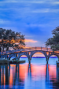 Twilight reflection of the wooden bridge that connects the Whale Head Club to Currituck Beach Lighthouse.