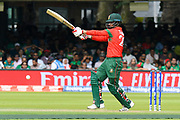 Tamim Iqbal of Bangladesh plays an attacking shot during the ICC Cricket World Cup 2019 match between Pakistan and Bangladesh at Lord's Cricket Ground, St John's Wood, United Kingdom on 5 July 2019.