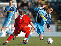 Photo: Leigh Quinnell.<br /> Wycombe Wanderers v Shrewsbury Town. Coca Cola League 2. 11/03/2006. Wycombes Danny Senda finds a way past Shrewsburys Colin McMenamin.