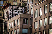 May 5, 2014 - New York, NY. An apartment building has crowded out this fading sign on Sixth Avenue between 27th and 26 streets. 05/05/2014 Photograph by Kevin R. Convey/NYCity Photo Wire.