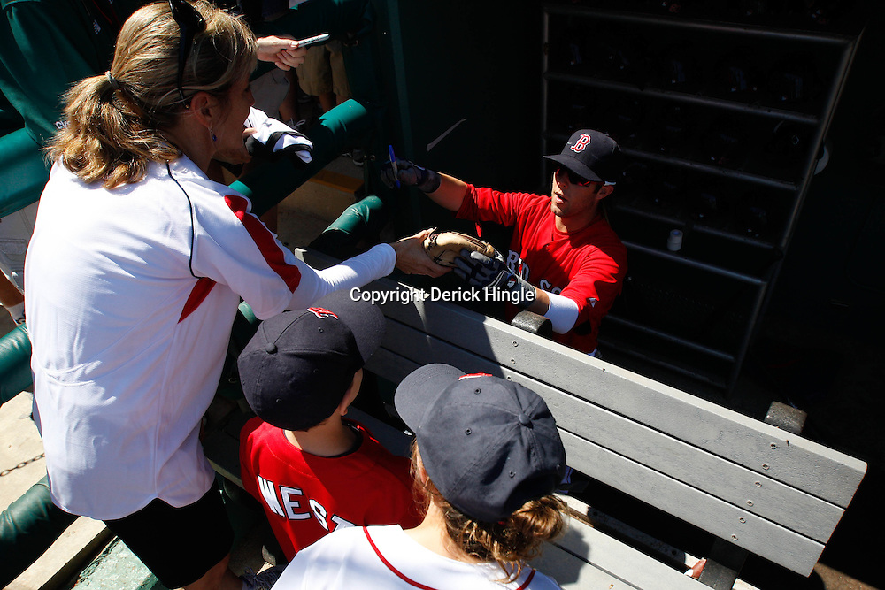 March 7, 2011; Fort Myers, FL, USA; Boston Red Sox second baseman Dustin Pedroia (15) signs autographs for fans before a spring training exhibition game against the Baltimore Orioles at City of Palms Park.   Mandatory Credit: Derick E. Hingle