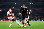 Arsenal's Eddie Nketiah (49) and Qarabag FK's Simeon Slavchev (6) during the Europa League group stage match between Arsenal and FK QARABAG at the Emirates Stadium, London, England on 13 December 2018.