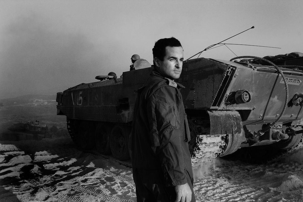 An officer watches as tanks cross the border into Lebanon during the Israel/Hezbollah war. Aug 2006