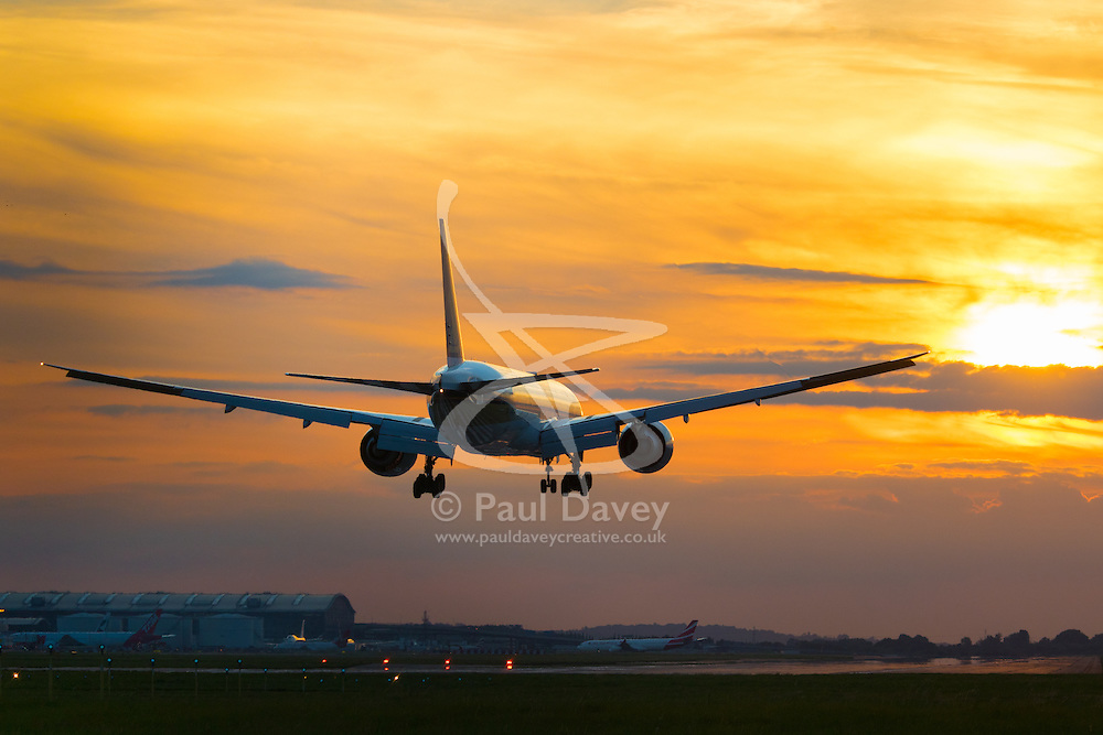 London Heathrow, September 19th 2015. A Sinagpore Airlines Cargo Boeing 777-F Freighter lands during unset on Runway 27R at London Heathrow.
