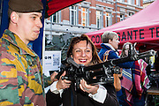 Brussels, Belgium 20160313 The Royal Belgian Military Academy had its yearly open day in Etterbeek, Brussels.The Royal Military Academy is a military institution of university education responsible for the basic academic, military and physical training of future officers.Woman feeling the weight of a gun