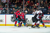KELOWNA, CANADA - MARCH 16: Kyle Topping #24 of the Kelowna Rockets digs the puck away from the boards during second period against the Vancouver Giants  on March 16, 2019 at Prospera Place in Kelowna, British Columbia, Canada.  (Photo by Marissa Baecker/Shoot the Breeze)