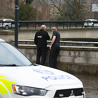 Officers from Police Scotland pictured on Tay Street in Perth looking at the River Tay where they today continued the search for a body after an off duty firefighter reported spotting a body in the river last night (Sunday 23.02.14). The search was halted at 9.30pm Sunday evening....24.02.14<br /> Picture by Graeme Hart.<br /> Copyright Perthshire Picture Agency<br /> Tel: 01738 623350  Mobile: 07990 594431