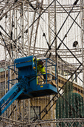 Pictured: <br /> Edinburgh's George Street has been changed into a pedestrian thoroughfare for the festive season and workmen with a head for heights have been busy decorating the street for the festivities.<br /> <br /> <br /> Ger Harley | EEm 14 November 2017