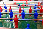 Blue and red players on a foosball table