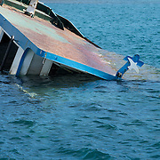 Greece, Levos, Petra. Around 200 people had arrived earlier. A  boat , now sunk, that was used to transport refugees.