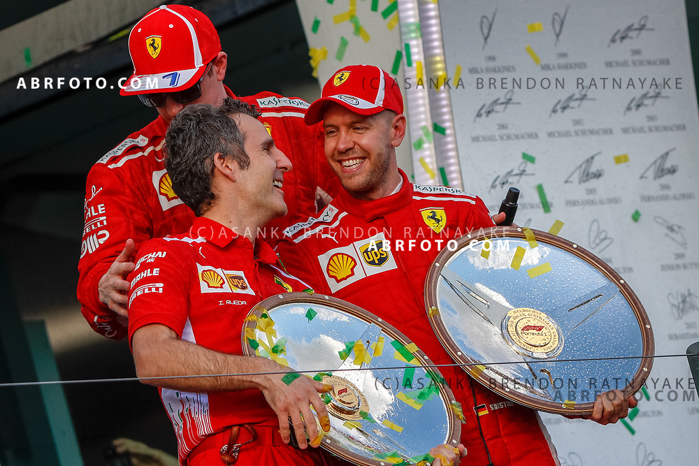 Inaki Rueda, Ferrari Race Strategist and ferrari Ferrari driver Kimi Raikkonen of Finland and Ferrari driver Sebastian Vettel of Germany drivers on the podium on the podium during the trophy presentation at the end of the 2018 Rolex Formula 1 Australian Grand Prix at Albert Park, Melbourne, Australia, March 24, 2018.  Asanka Brendon Ratnayake