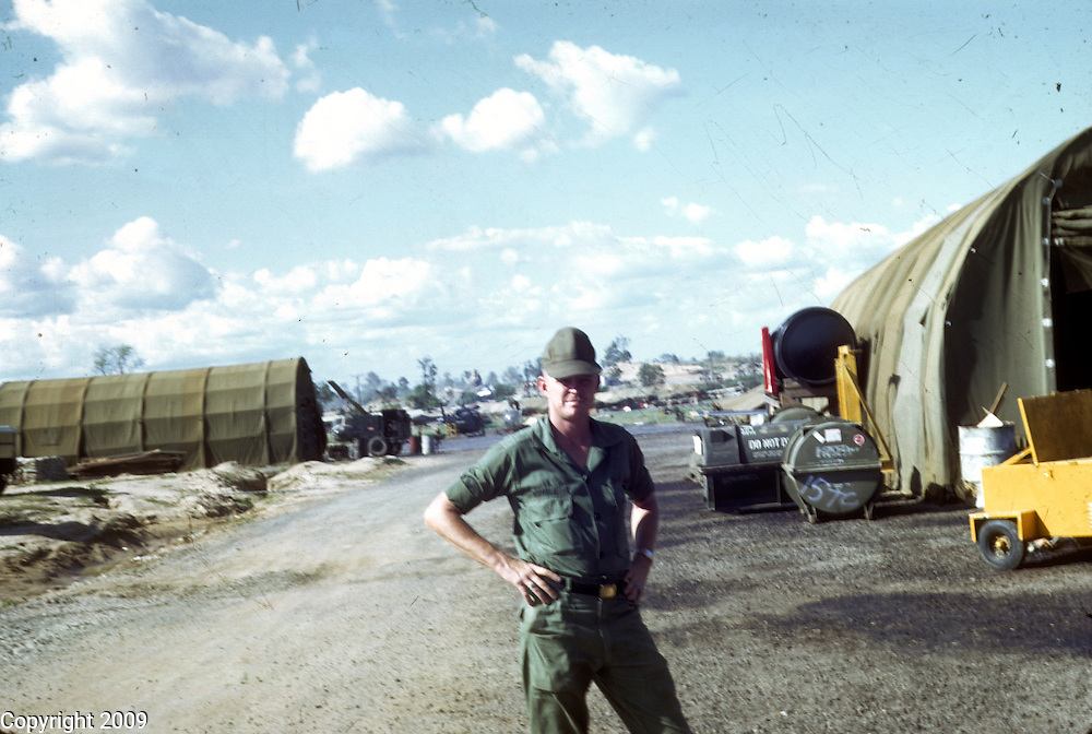 A soldier stands for a photo in Vietnam. This images is from the collection of J.W. Womble of the 610th Transportation Company during the Vietnam War.