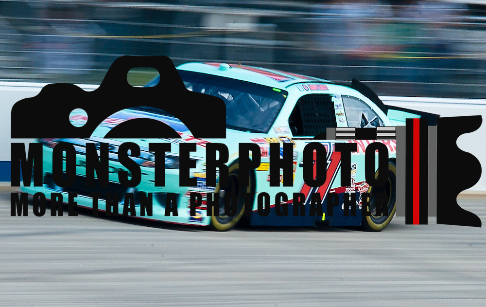 Andy Lally #71 rounds turn two during Sprint Cup Series Practice session Friday, Sept. 30, 2011 at Dover International Speedway in Dover Delaware.